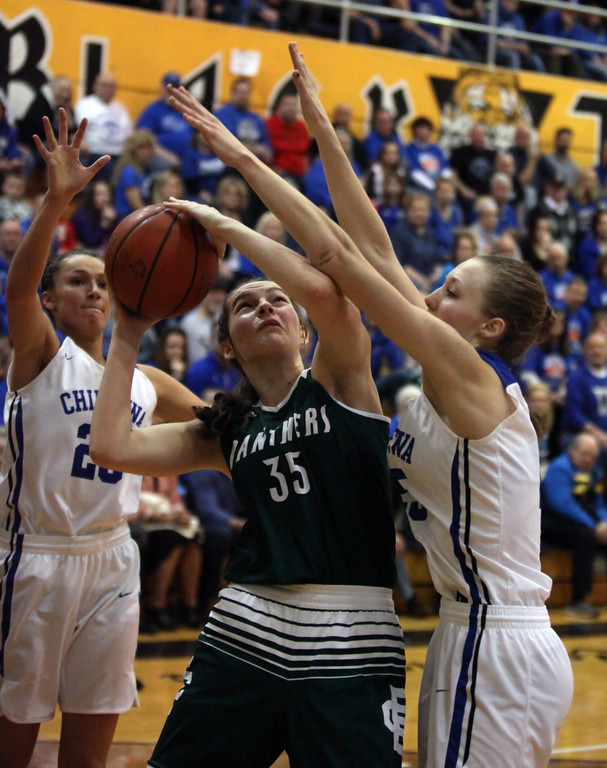 . Elyria Catholic\'s Megan Scheibelhut attempts to shoot in between Celina Koncz (left) and Grace Lindquist of Chippewa during the fourth quarter. Randy Meyers -- The Morning Journal