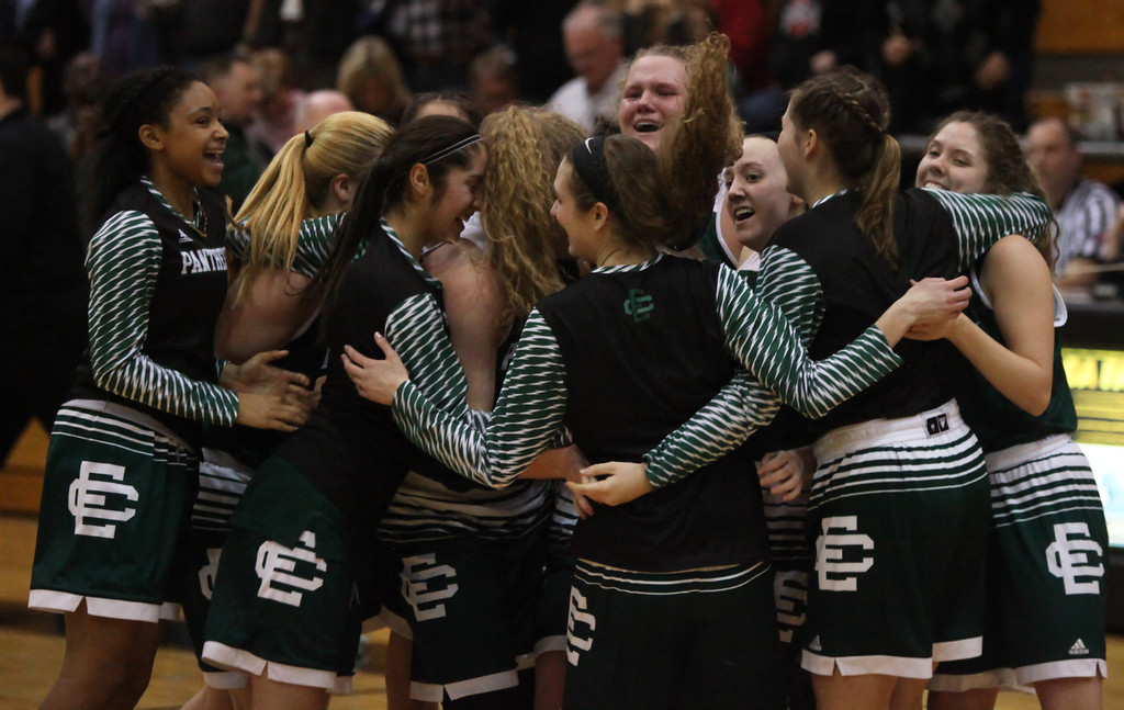 . The Elyria Catholic girls basketball team celebrates its regional crown. Randy Meyers -- The Morning Journal