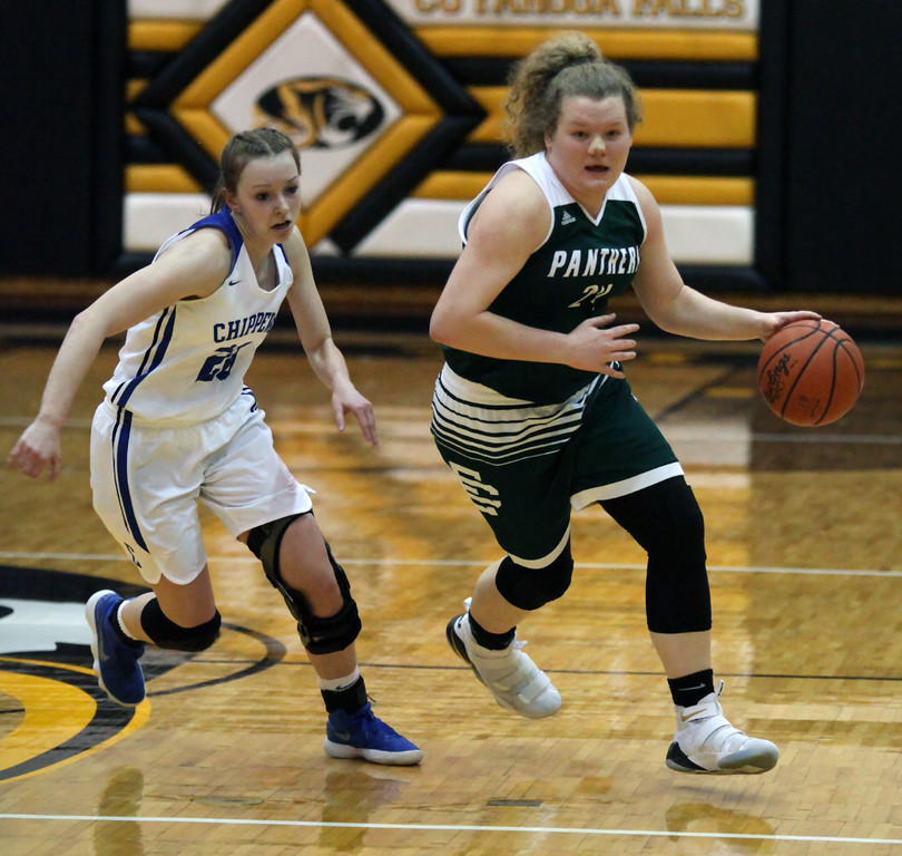 . Abby Winnen of Elyria Catholic drives around Katie Richardson of Chippewa during the third quarter. Randy Meyers -- The Morning Journal