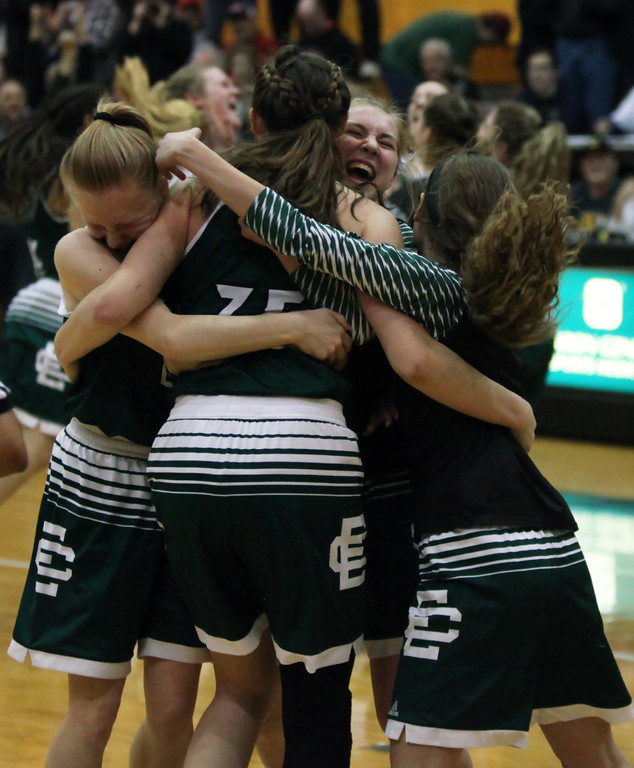 . The Elyra Catholic girls basketball team celebrates after the final buzzer in their win over Doylestown Chippewa in a regional final. Randy Meyers -- The Morning Journal
