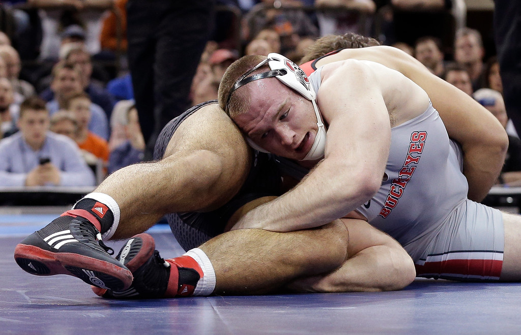 . Ohio State\'s Kyle Snyder, right, works for control against North Carolina State\'s Nick Gwiazdowski during the 285-pound championship match of the NCAA Division I wrestling championships, Saturday, March 19, 2016, in New York. Snyder won the bout in overtime. (AP Photo/Julie Jacobson)