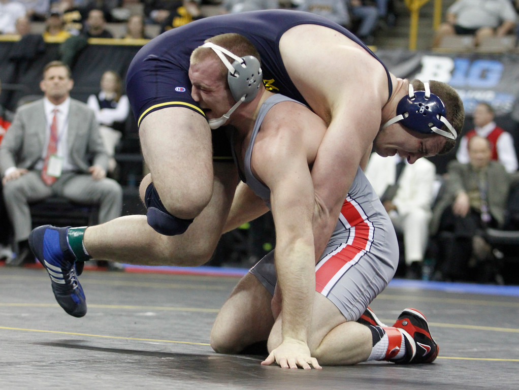 . Ohio State\'s Kyle Snyder, bottom, competes with Michigan\'s Adam Coon, top, in the heavyweight class finals during the Big Ten wrestling championships at Carver-Hawkeye Arena in Iowa City, Iowa, on Sunday, March 6, 2016. (AP Photo/Matthew Holst)