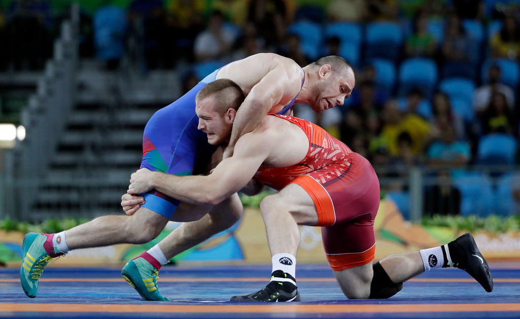 . United States\' Kyle Frederick Snyder, bottom, and Azerbaijan\'s Khetag Goziumov compete during the men\'s 97-kg freestyle gold medal wrestling match at the 2016 Summer Olympics in Rio de Janeiro, Brazil, Saturday, Aug. 20, 2016. (AP Photo/Marcio Jose Sanchez)