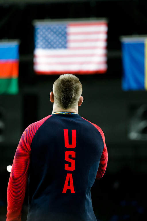 . Gold medalist United States\' Kyle Frederick Snyder listen to the United Staes\' national anthem during the winners ceremony of the men\'s 97-kg freestyle wrestling competition at the 2016 Summer Olympics in Rio de Janeiro, Brazil, Sunday, Aug. 21, 2016. (AP Photo/Markus Schreiber)