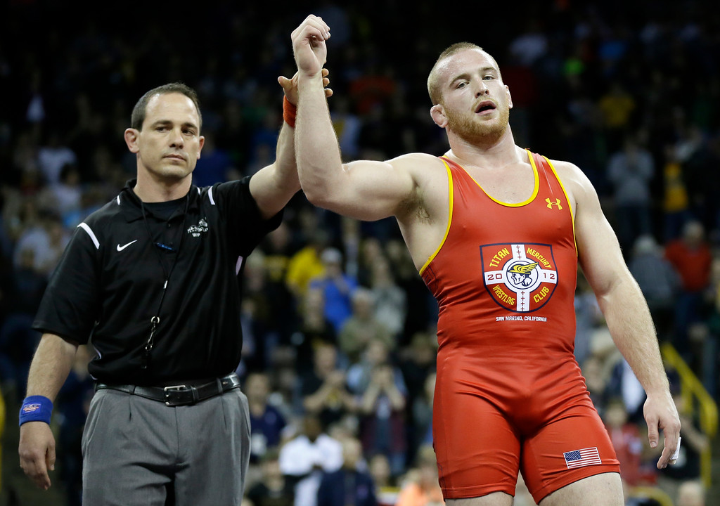 . Kyle Snyder, right, reacts after beating Jake Varner in their 97-kilogram freestyle final match at the U.S. Olympic Wrestling Team Trials, Sunday, April 10, 2016, in Iowa City, Iowa. (AP Photo/Charlie Neibergall)