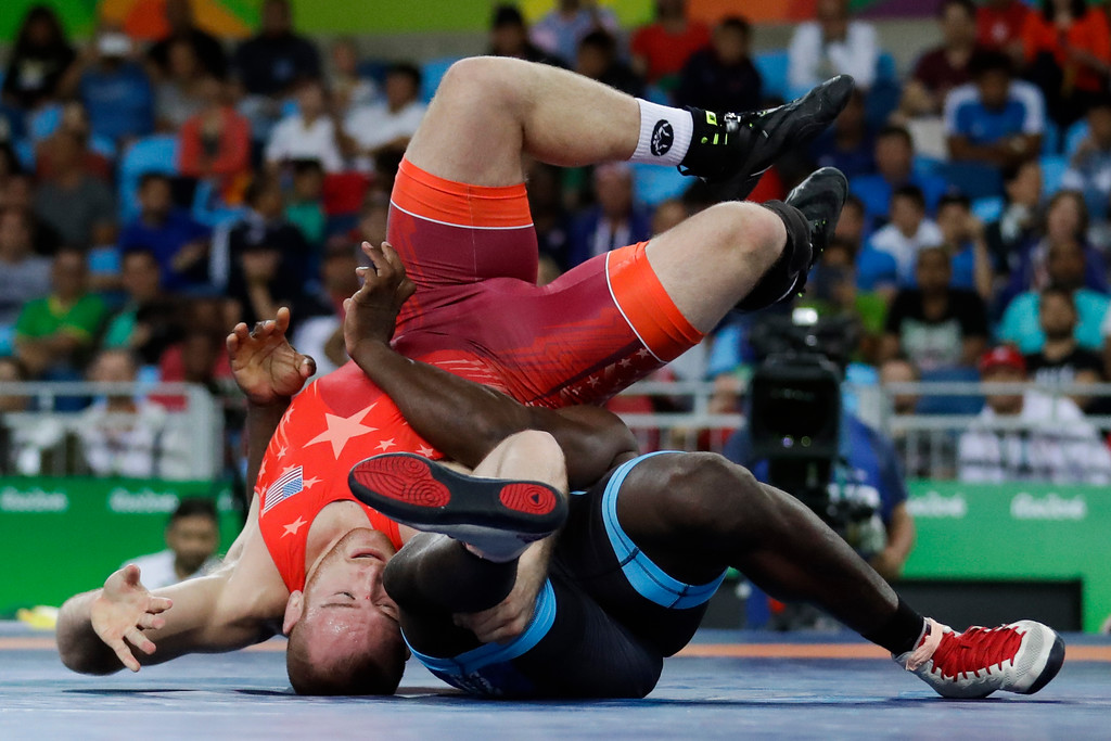 . United States\' Kyle Frederick Snyder, red, competes against Cuba\'s Javier Cortina Lacerra during the men\'s 97-kg freestyle wrestling competition at the 2016 Summer Olympics in Rio de Janeiro, Brazil, Sunday, Aug. 21, 2016. (AP Photo/Markus Schreiber)