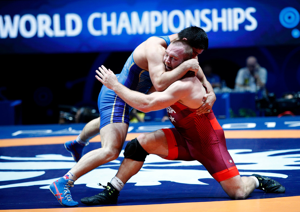 . United States\' Kyle Frederick Snyder, red, and Abdulrashid Sadulaev of Russia compete in the men\'s free style 97 kg category during the final of the Wrestling World Cup at the Paris Bercy Arena, in Paris, France, Saturday, Aug. 26, 2017. (AP Photo/Christophe Ena)