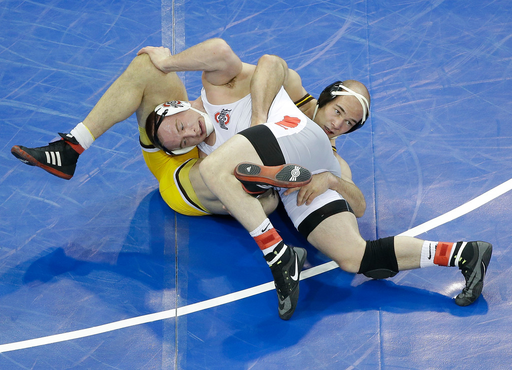 . Ohio State\'s Kyle Snyder, left, rolls Wyoming\'s Tanner Harms on his back in a 285-pound weight class match during the second round of the NCAA Divison I Wrestling Championships, Thursday, March 17, 2016, in New York. Snyder won the match. (AP Photo/Julie Jacobson)