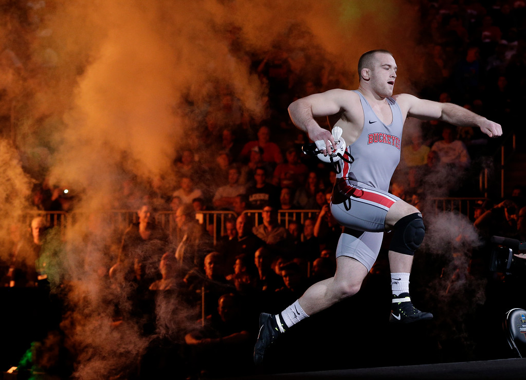 . Ohio State\'s Kyle Snyder leaps onto the stage as before the start of the 285-pound championship match against North Carolina State\'s Nick Gwiazdowski in the NCAA Division I Wrestling Championships, Saturday, March 19, 2016, in New York. (AP Photo/Julie Jacobson)
