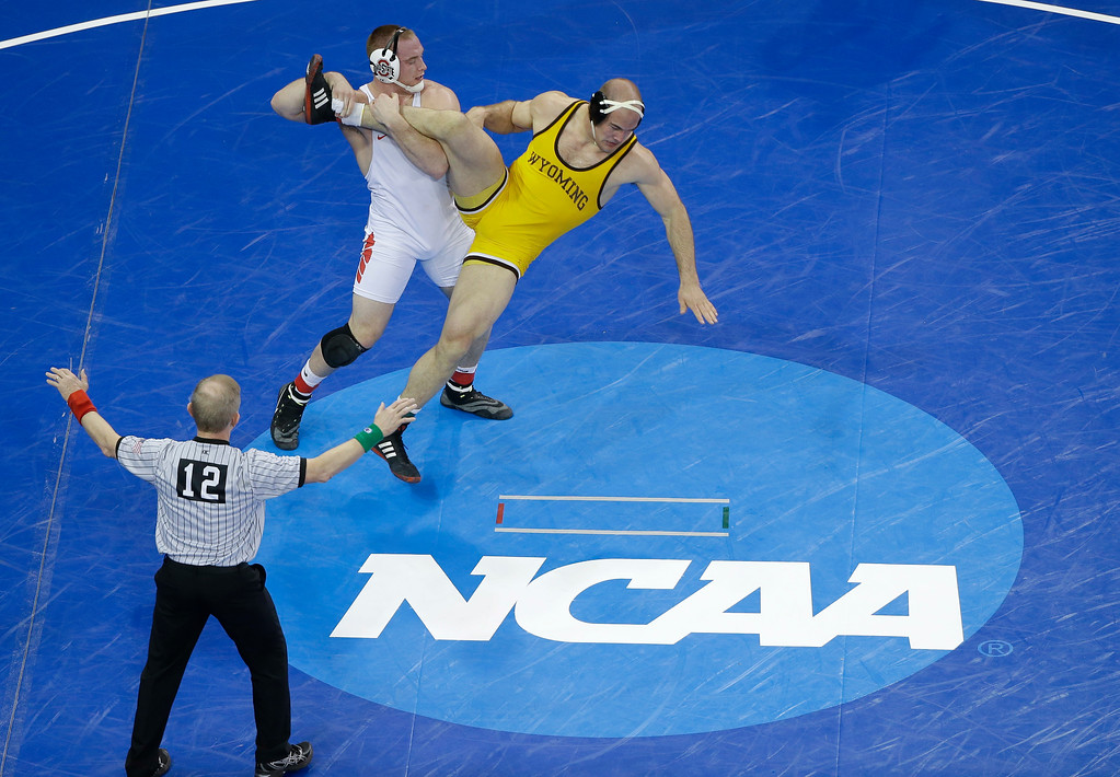 . Ohio State\'s Kyle Snyder, left, takes down Wyoming\'s Tanner Harms in a 285 pound weight class match during the second round of the NCAA Divison I Wrestling Championships, Thursday, March 17, 2016, in New York. Snyder won the match. (AP Photo/Julie Jacobson)