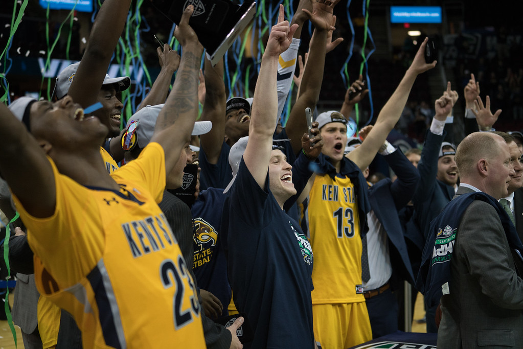 . Kent State players celebrate defeating Akron in the Men\'s MAC Tournament Championship at the Quicken Loans Arena in Cleveland, OH on March 11, 2016.  Kent State defeated Akron 70-65 to advance to the NCAA Tournament.