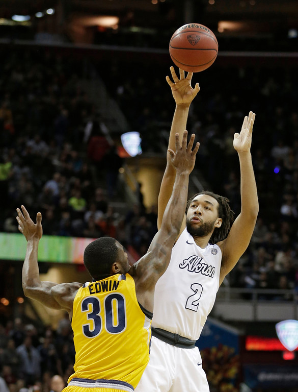 . Akron\'s Kwan Cheatham, right, shoots over Kent State\'s Deon Edwin during the first half of an NCAA college basketball championship game of the Mid-American Conference tournament, Saturday, March 11, 2017, in Cleveland. (AP Photo/Tony Dejak)