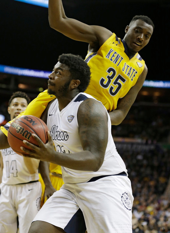 . Akron\'s Isaiah Johnson, left, is fouled by Kent State\'s Jimmy Hall during the second half of an NCAA college basketball championship game of the Mid-American Conference tournament, Saturday, March 11, 2017, in Cleveland. Kent State won 70-65. (AP Photo/Tony Dejak)