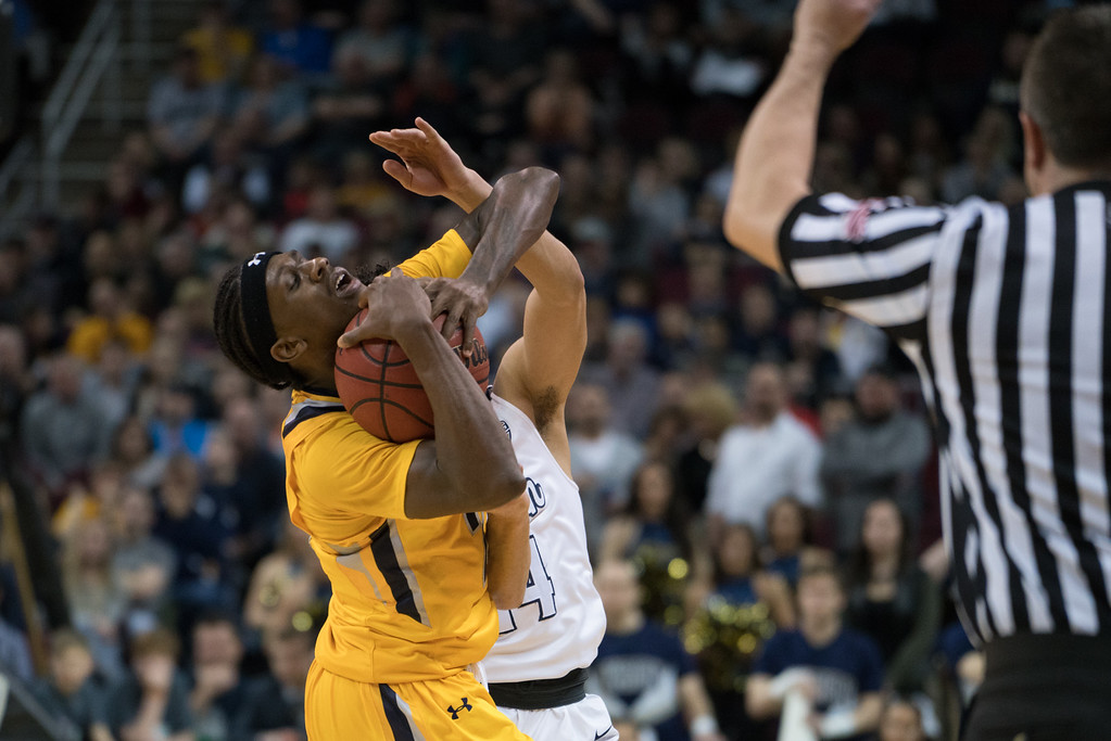 . Kent State\'s Jaylin Walker is fouled in the final moments of  the Men\'s MAC Tournament Championship at the Quicken Loans Arena in Cleveland, OH on March 11, 2016.  Kent State defeated Akron 70-65 to advance to the NCAA Tournament.