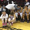 Northern Ilinois bench, somber postgame scene