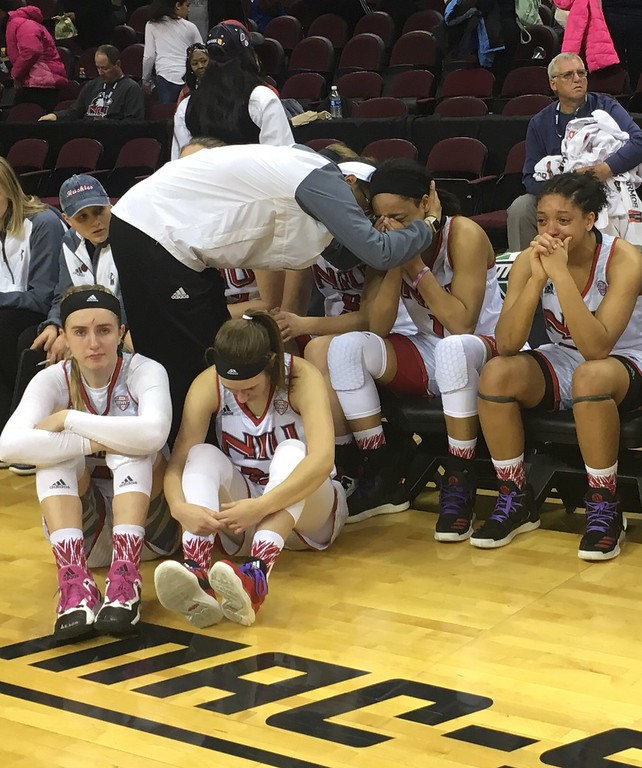 . Northern Ilinois bench, somber postgame scene