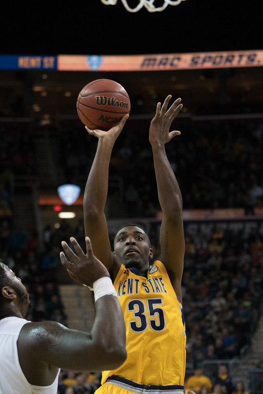 . Kent State\'s Jimmy Hall takes a shot over an Akron defender during the Men\'s MAC Tournament Championship at the Quicken Loans Arena in Cleveland, OH on March 11, 2016. Kent State defeated Akron 70-65 to advance to the NCAA Tournament.