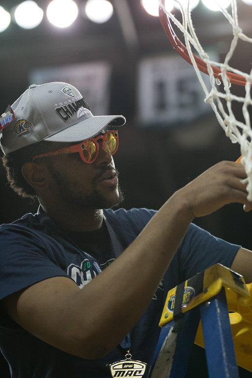 . Kent State\'s Adonis De La Rosa cuts a piece of the net after defeating Akron in the Men\'s MAC Tournament Championship at the Quicken Loans Arena in Cleveland, OH on March 11, 2016.  Kent State defeated Akron 70-65 to advance to the NCAA Tournament.