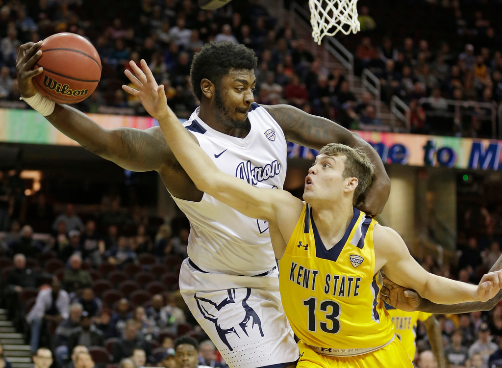 . Akron\'s Isaiah Johnson, left, grabs a rebound ahead of Kent State\'s Mitch Peterson during the first half of an NCAA college basketball championship game of the Mid-American Conference tournament, Saturday, March 11, 2017, in Cleveland. (AP Photo/Tony Dejak)