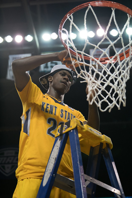 . Kent State\'s Jaylin Walker cuts a piece of the net after defeating Akron in the Men\'s MAC Tournament Championship at the Quicken Loans Arena in Cleveland, OH on March 11, 2016.  Kent State defeated Akron 70-65 to advance to the NCAA Tournament.