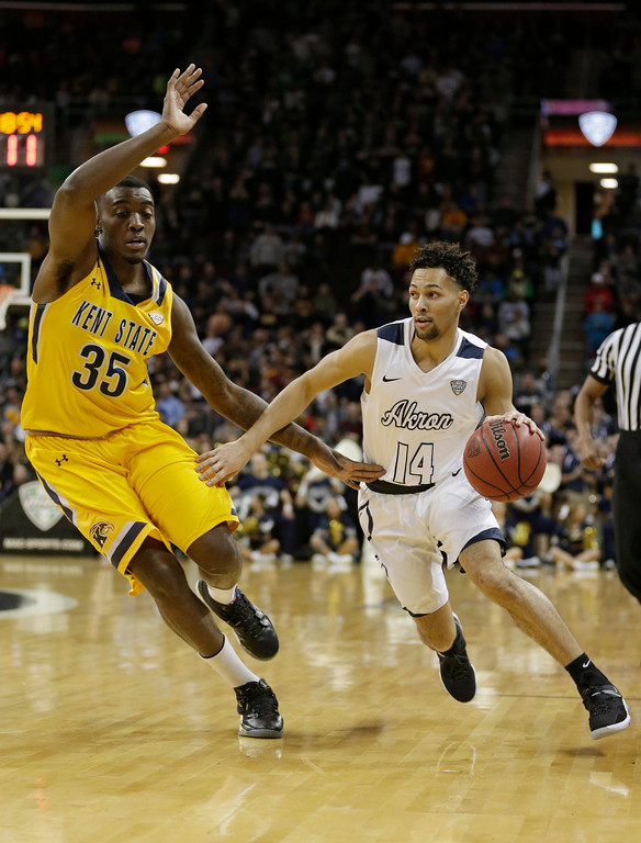 . Akron\'s Noah Robotham, right, drives past Kent State\'s Jimmy Hall during the first half of an NCAA college basketball championship game of the Mid-American Conference tournament, Saturday, March 11, 2017, in Cleveland. (AP Photo/Tony Dejak)