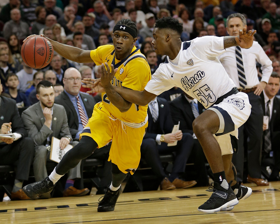. Kent State\'s Jaylin Walker, left, drives against Akron\'s Antino Jackson during the first half of an NCAA college basketball championship game of the Mid-American Conference tournament, Saturday, March 11, 2017, in Cleveland. (AP Photo/Tony Dejak)