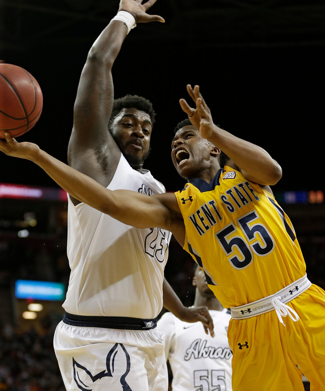 . Kent State\'s Kevin Zabo (55) drives past Akron\'s Isaiah Johnson (23) during the first half of an NCAA college basketball championship game of the Mid-American Conference tournament, Saturday, March 11, 2017, in Cleveland. (AP Photo/Tony Dejak)