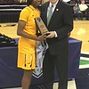 MAC Women's tournament MVP Mikeala Boyd of Toledo and MAC Commissioner Jon Steinbrecher