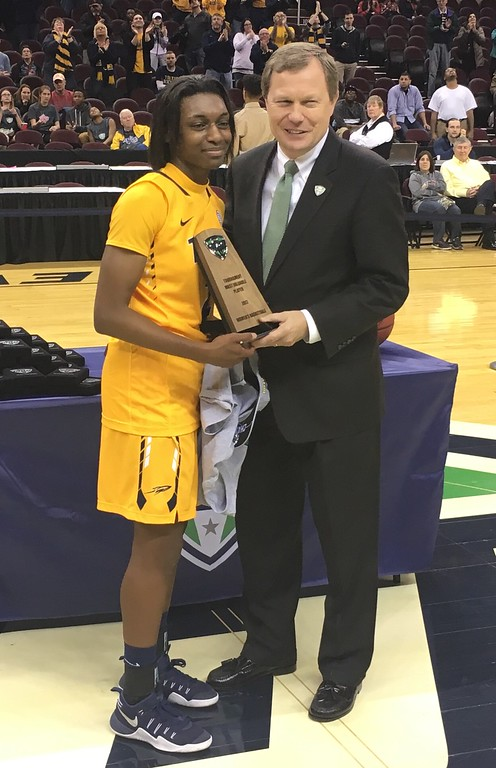 . MAC Women\'s tournament MVP Mikeala Boyd of Toledo and MAC Commissioner Jon Steinbrecher