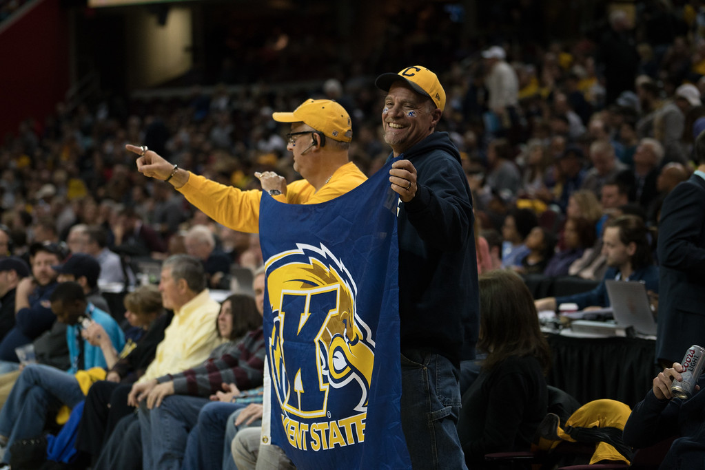 . Mike Johann (right) and Bob Milliken (left) cheer on Kent State in the Men\'s MAC Tournament Championship at the Quicken Loans Arena in Cleveland, OH on March 11, 2016.  Kent State defeated Akron 70-65 to advance to the NCAA Tournament.