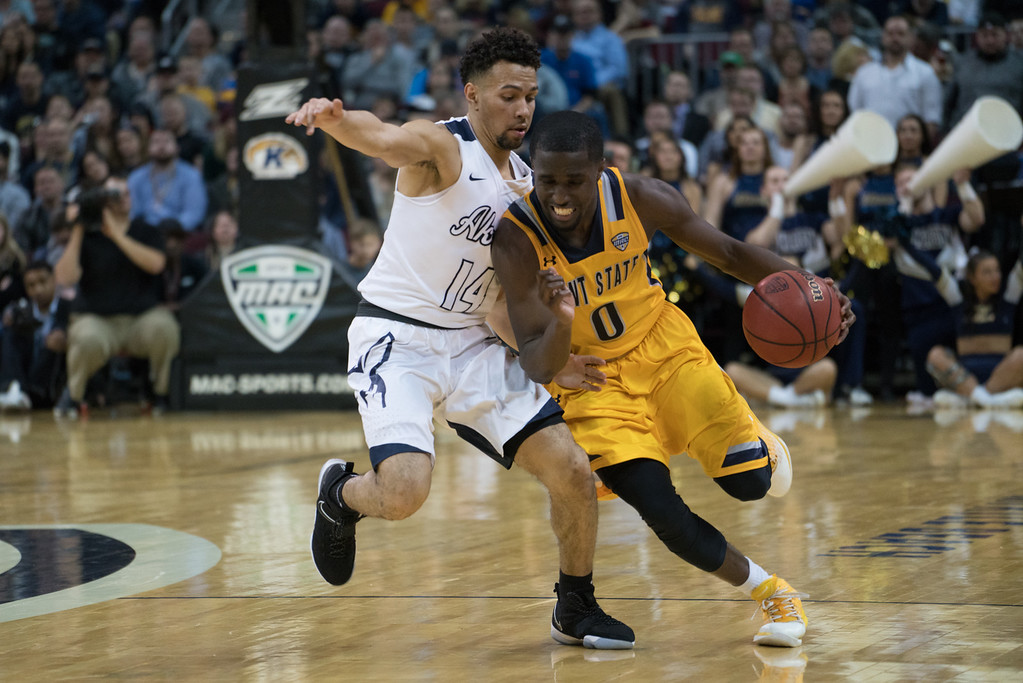 . Kent State\'s Jalen Avery (0) drives past Akron\'s Noah Robotham (14) during the Men\'s MAC Tournament Championship at the Quicken Loans Arena in Cleveland, OH on March 11, 2016.  Kent State defeated Akron 70-65 to advance to the NCAA Tournament.