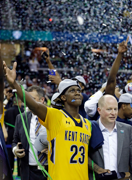 . Kent State\'s Jaylin Walker, left, takes it all in, standing next to head coach Rob Senderoff after an NCAA college basketball championship game of the Mid-American Conference tournament against Akron, Saturday, March 11, 2017, in Cleveland. Kent State won 70-65. (AP Photo/Tony Dejak)