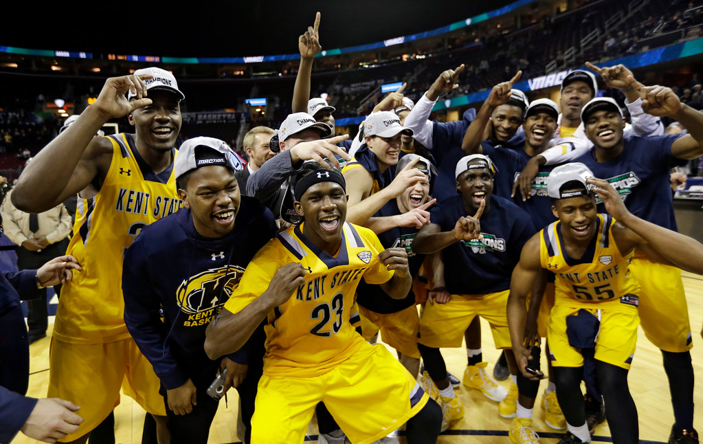 . Kent State teammates celebrate after Kent State defeated Akron 70-65 during an NCAA college basketball championship game of the Mid-American Conference tournament, Saturday, March 11, 2017, in Cleveland. (AP Photo/Tony Dejak)