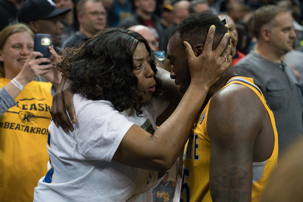 . Kent State\'s Jimmy Hall hugs his Mother after defeating Akron in the Men\'s MAC Tournament Championship at the Quicken Loans Arena in Cleveland, OH on March 11, 2016.  Kent State defeated Akron 70-65 to advance to the NCAA Tournament.