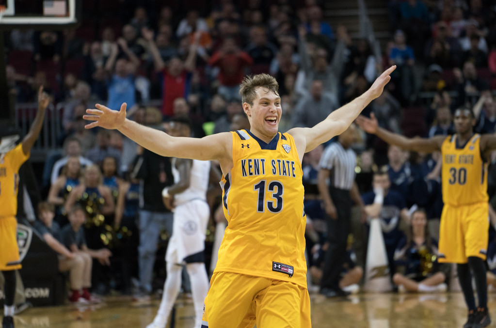 . Kent State\'s Mitch Peterson celebrates after defeating Akron in the Men\'s MAC Tournament Championship at the Quicken Loans Arena in Cleveland, OH on March 11, 2016.  Kent State defeated Akron 70-65 to advance to the NCAA Tournament.