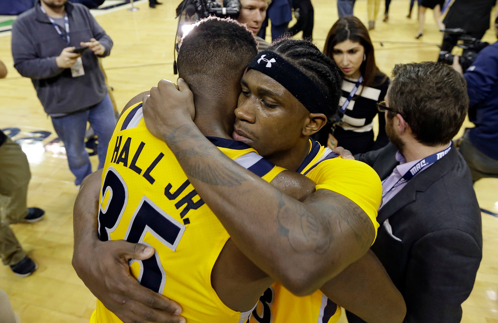 . Kent State\'s Jaylin Walker, right, hugs Jimmy Hall after an NCAA college basketball championship game of the Mid-American Conference tournament, Saturday, March 11, 2017, in Cleveland. Kent State defeated Akron 70-65. (AP Photo/Tony Dejak)