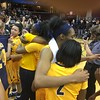 Toledo players hug it out after beating Northern Illinois in the MAC Women's Tournament itle game.