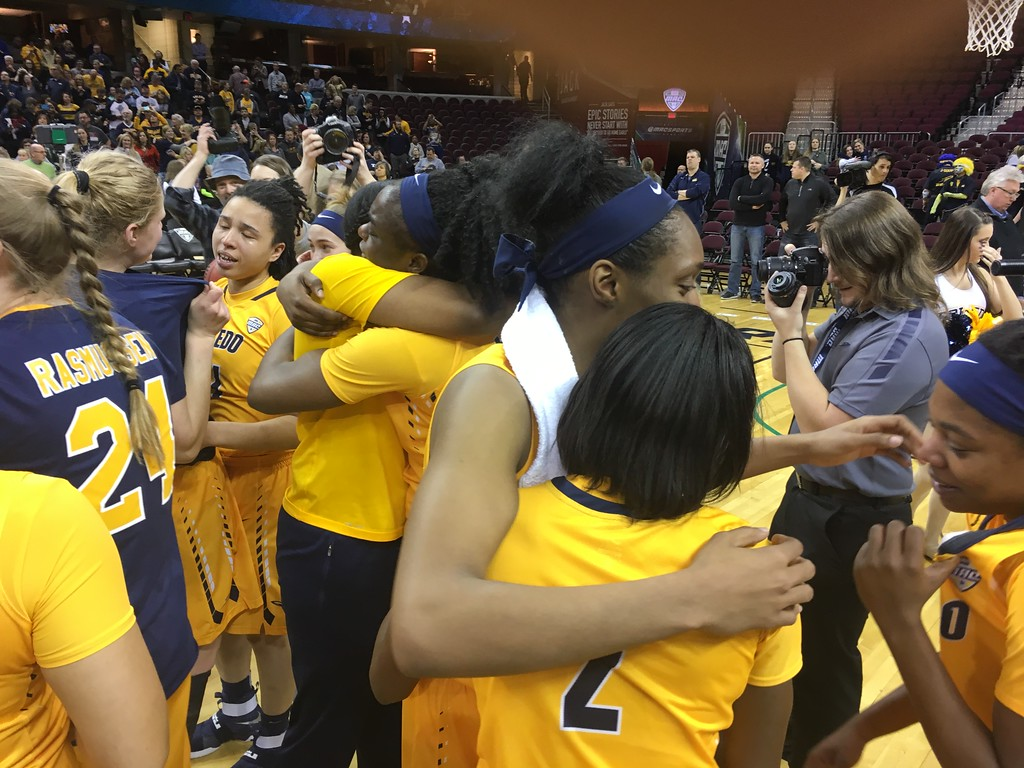 . Toledo players hug it out after beating Northern Illinois in the MAC Women\'s Tournament itle game.