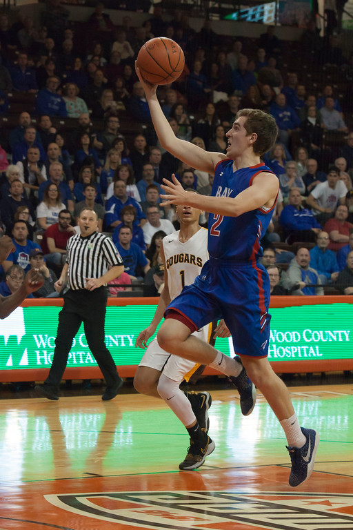 . Coming down the middle of the lane Bay\'s Daniel Brajdic outpaces Beechcroft\'s Elijah Bishop to toss the basketball up for two. Jen Forbus -- The Morning Journal
