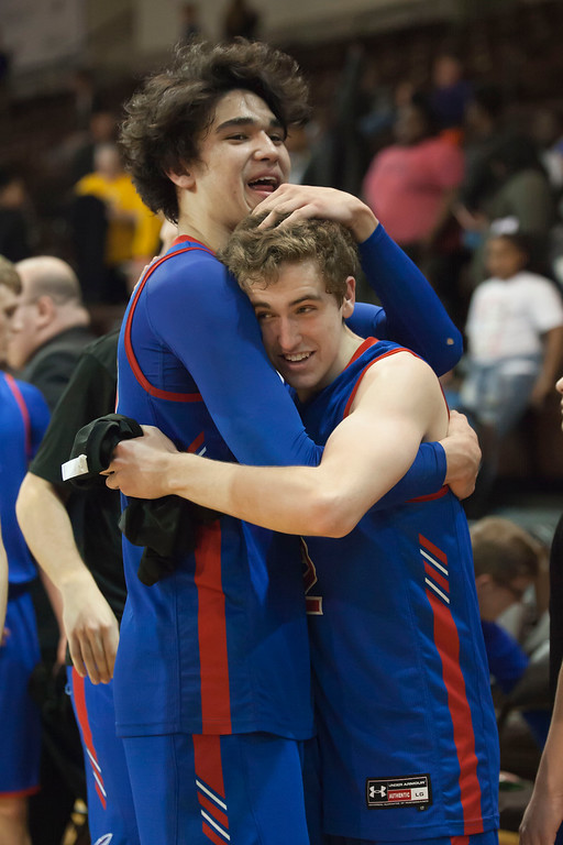 . Bay\'s RJ Sunahara and Daniel Brajdic share a celebratory hug following their hard-earned win against the Beechcroft Cougars in the regional semifinal game. Jen Forbus -- The Morning Journal