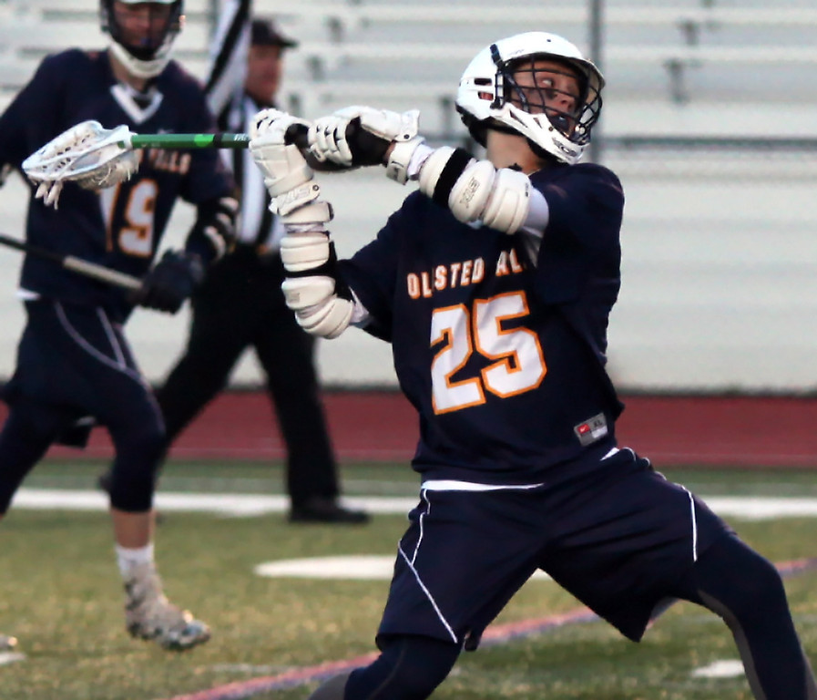 . Dylan Varga of Olmsted Falls takes a long shot on goal against Avon during the first quarter. Randy Meyers -- The Morning Journal