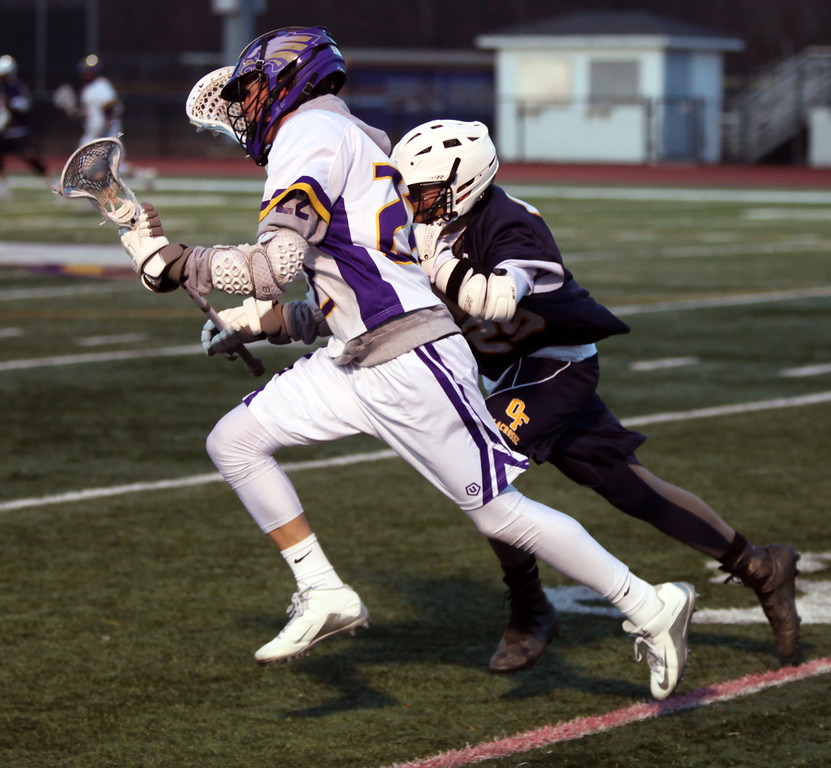 . Avon\'s Austin Roman runs the ball past Dylan Varga of Olmsted Falls near the sideline during the first quarter. Randy Meyers -- The Morning Journal