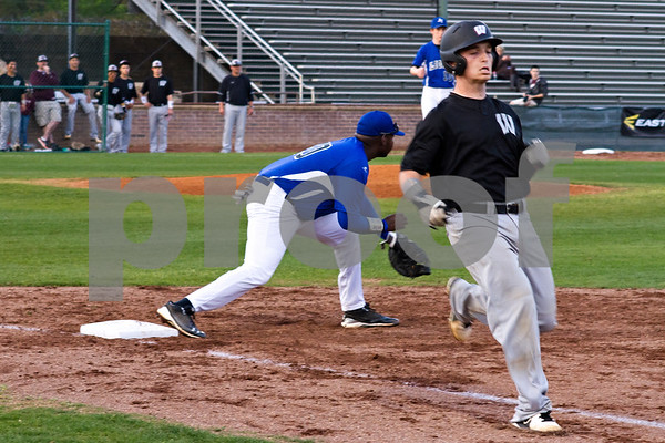 Photo by Shannon Wilson / Tyler Morning Telegraph John Tyler's Kendall Holmes (20) anticipates a throw to first base as Whitehouse's Derek Clemons (10) makes it to first base during a game at Mike Carter Field on Friday.