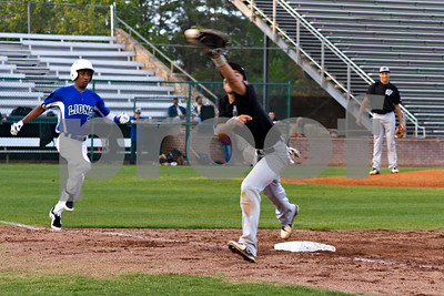 Photo by Shannon Wilson / Tyler Morning Telegraph Whitehouse's Michael Noon (7) attempts to catch the ball at first as John Tyler's Jerron Jones (2) runs to first during a game at Mike Carter Field on Friday.