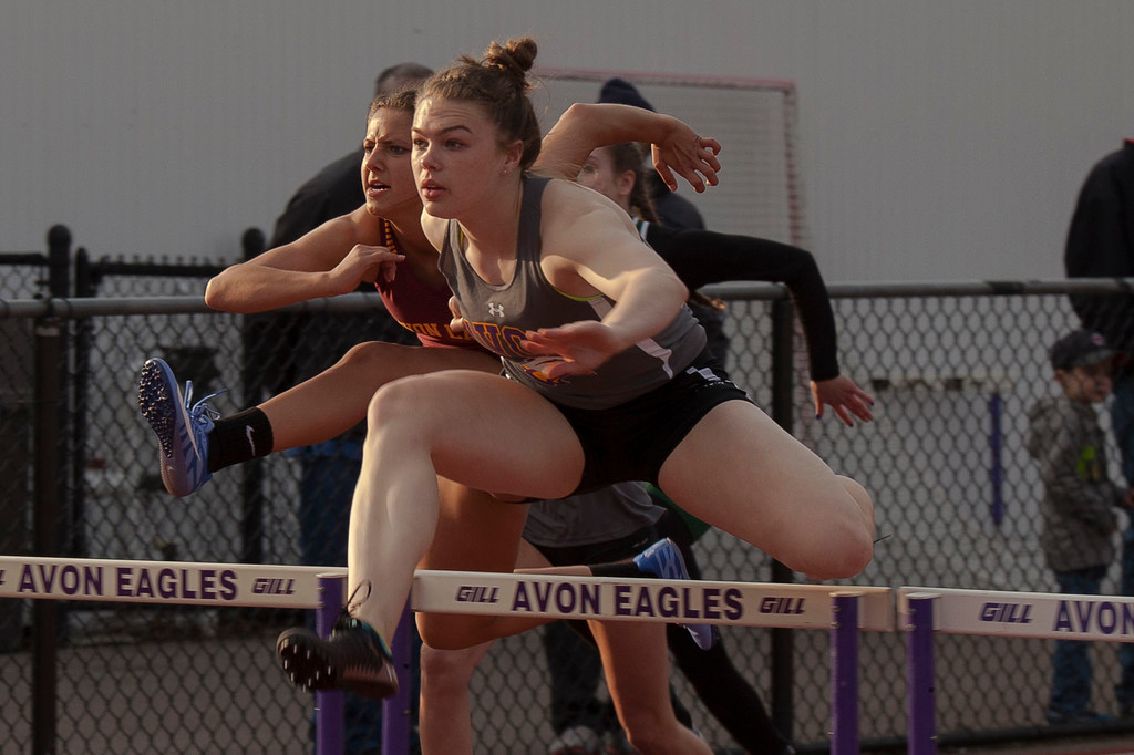 . Avon\'s Kamryn Sharer sails to win in the girls 100m hurdles at the LCCAAA Invitational Track Meet. Jen Forbus -- The Morning Journal