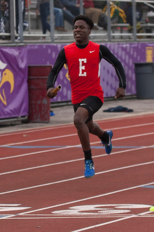 . Jayvion Benton crosses the finish line as the anchor of the winning Elyria boys\' 4x200 relay team. Jen Forbus -- The Morning Journal