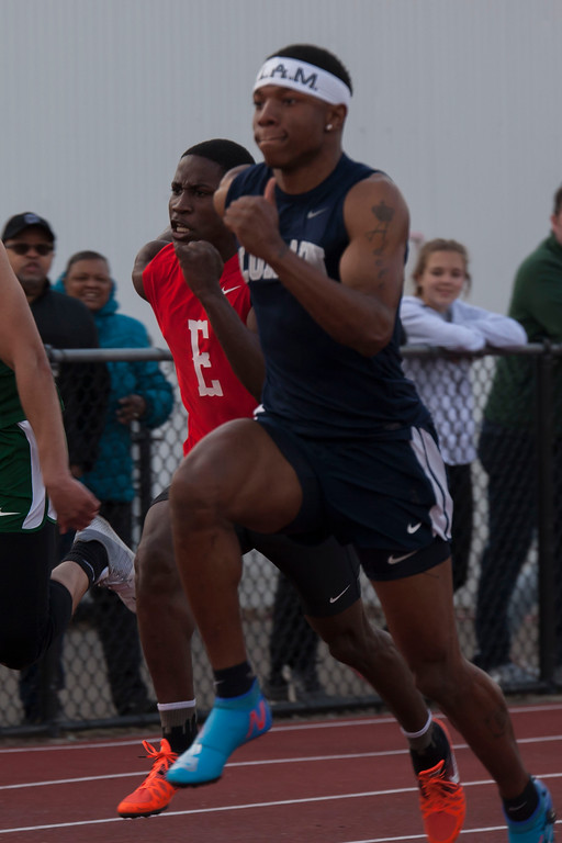 . Lorain\'s Zion Cross takes the 100m dash all in stride at Friday\'s Lorain County Invitational Track Meet. Jen Forbus -- The Morning Journal