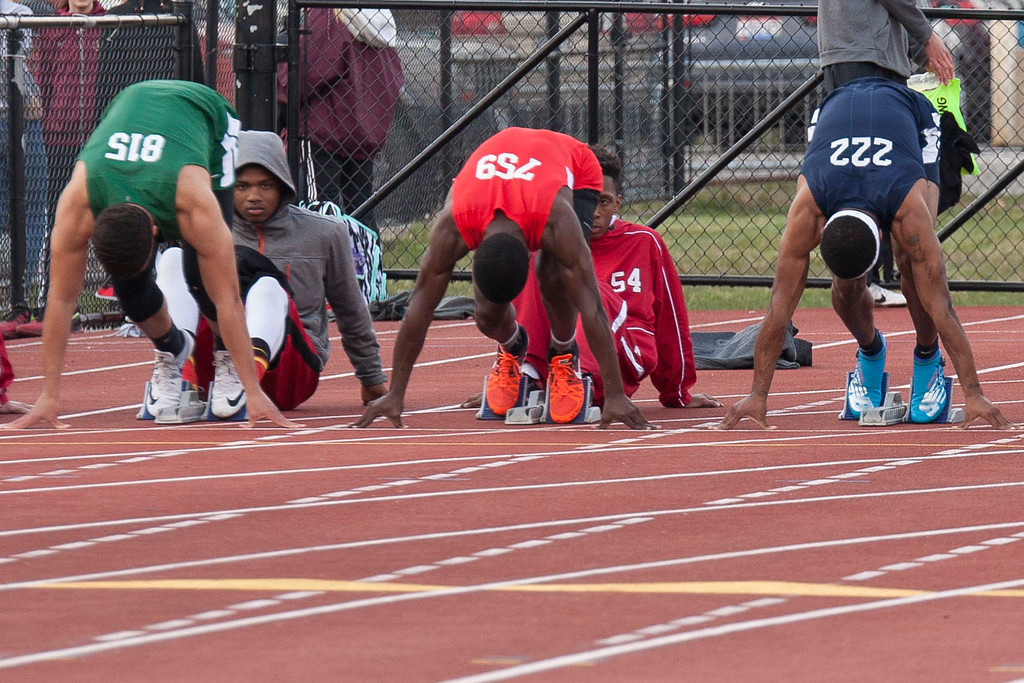 . Runners take their marks for the boys 100m dash at the Lorain County Invitational Track Meet. Jen Forbus -- The Morning Journal
