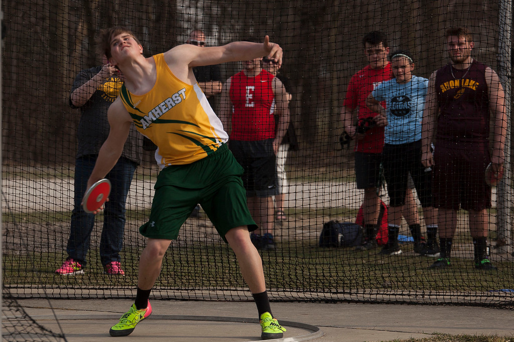 . Amherst\'s Jaret Prete slings the discus to win first place in the Lorain County Invitational Track Meet at Avon High School April 13. Jen Forbus -- The Morning Journal