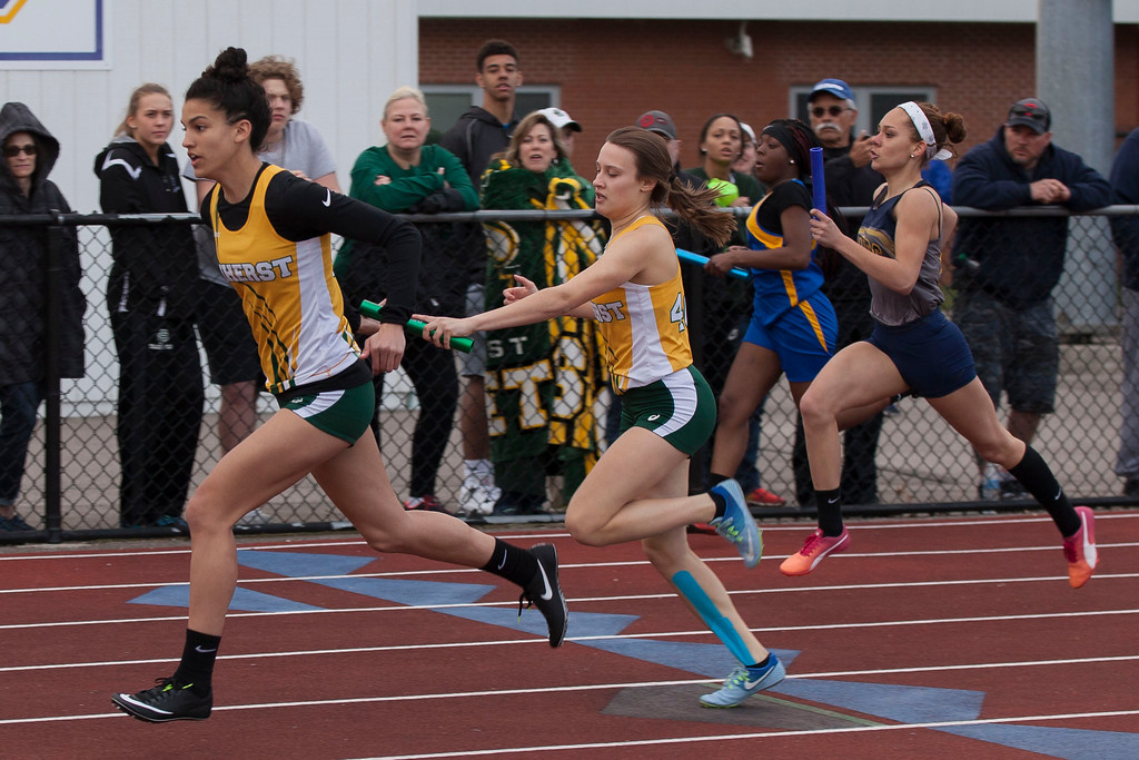 . Amherst\'s girls 4x200 relay team passes the baton on their way to a win at the LCAAA Invitational Track Meet. Jen Forbus -- The Morning Journal